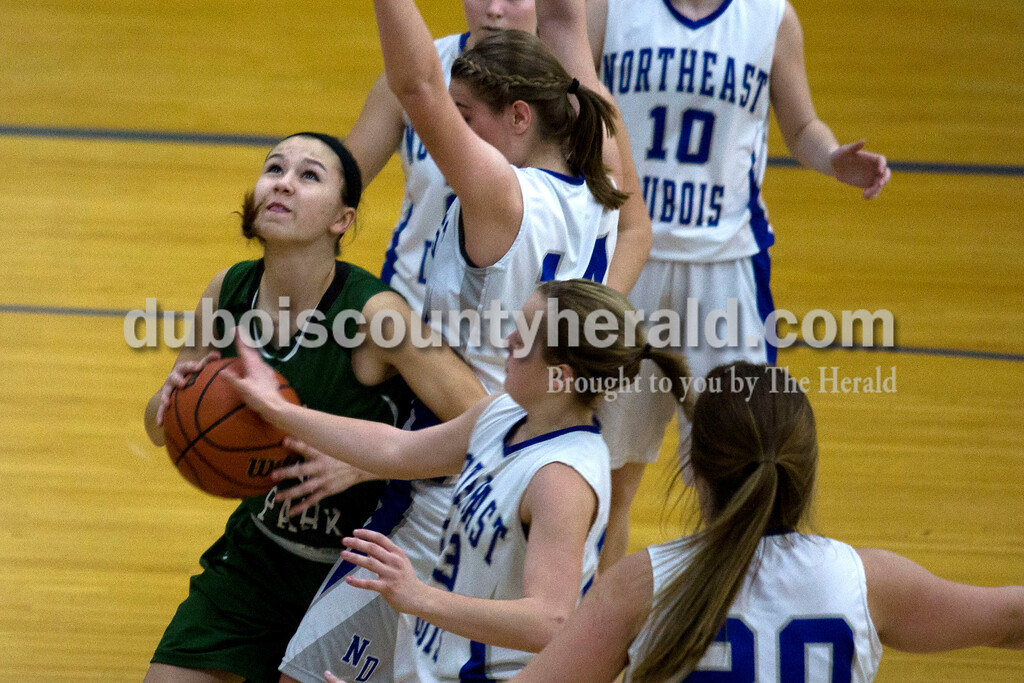 Alisha Jucevic/The Herald<br /> Forest Park's Lanette Blume eyed the basket as she tried to break through Northeast Dubois defense during Tuesday night's game in Dubois. Forest Park won 55-50 in overtime.