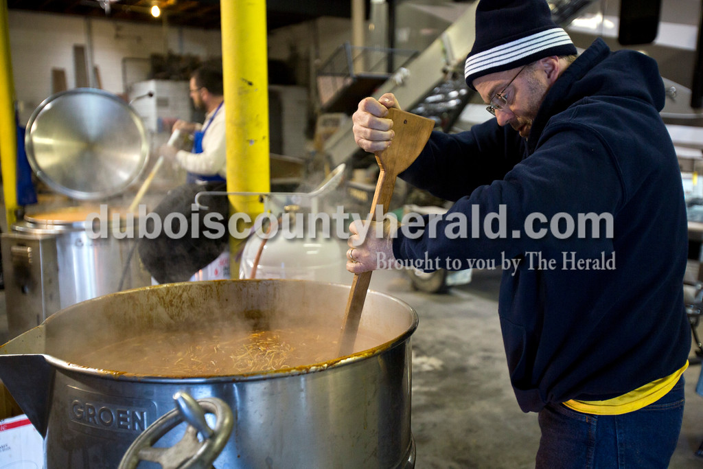 Alisha Jucevic/The Herald<br /> Andrew Danzer of Jasper stirred the chili soup during a fundraiser for the St. Joe's Boy Scouts troop 182 on Saturday at Hedinger Roofing in Jasper. The troop made a total of 150 gallons of soup, 100 gallons of mock turtle soup and 50 gallons of chili soup. Proceeds will go toward troop funds, including a summer trip to the Grand Canyon.