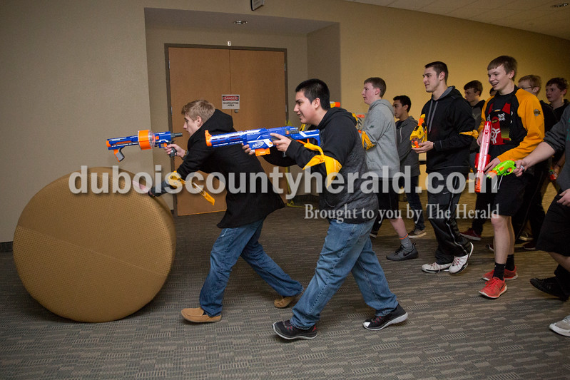 "Led by Max Hill of Jasper, 15, left, and Eric Monge of Ireland, 16, ""human"" participants patrolled the hallways looking for zombies  during Infected, a zombie-themed event hosted by The Well youth ministry at Christian Church of Jasper on Wednesday."