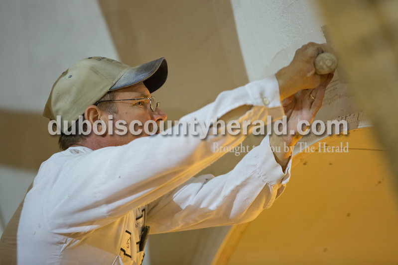 Sarah Ann Jump/The Herald<br /> Doug Mehringer of Jasper plastered an arch near the ceiling of St. Ferdinand Catholic Church in Ferdinand on Friday.