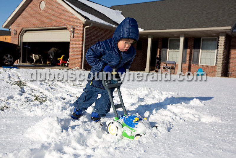 "Ariana van den Akker/The Herald<br /> Mathieu Thurston of Jasper, 3, plowed the front yard with his lawnmower outside his home on Tuesday afternoon. ""It keeps getting stuck!"" he said about the lawnmower."