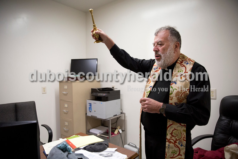 Father John Boeglin of Jasper blessed chief executive officer Stephen Bartels' office at Patoka Lake Winery in Birdseye on Tuesday, Jan. 12, 2016.