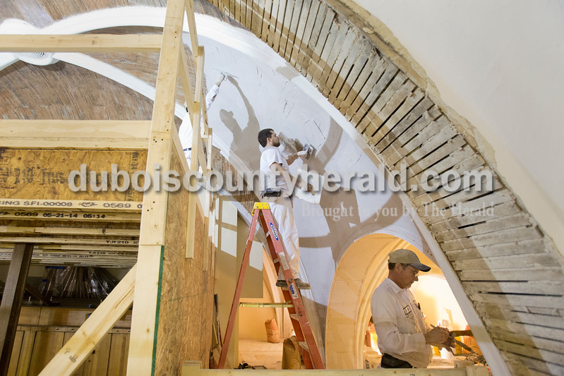 Sarah Ann Jump/The Herald<br /> Terry Kern of Birdseye, Kody Dorsam of Jasper and Doug Mehringer of Jasper plastered the arched ceiling of St. Ferdinand Catholic Church in Ferdinand on Friday.