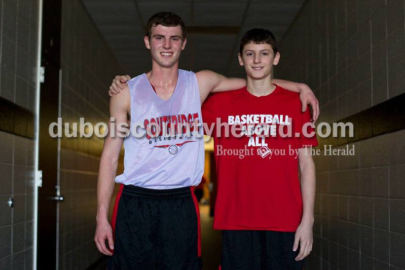 Alisha Jucevic/The Herald<br /> Southridge High School senior Jayden and his brother Southridge Middle School seventh-grader Colson Montgomery pose for a portrait together at Southridge High School. Jayden is in the starting lineup for Southridge's basketball team and Colson is an up and ing star playing for the middle school team.