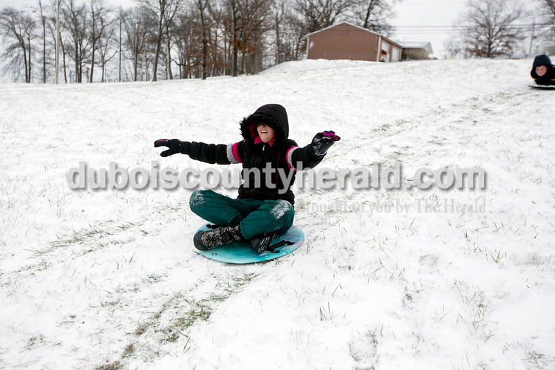 Ariana van den Akker/The Herald<br /> Rachel Dollaway of Huntingburg, 12, sledded down the hill at Niehaus Memorial Park in Huntingburg on Monday morning. All Dubois County schools were closed because of the snow and ice on Monday, though Rachel and her three siblings still had school in the afternoon because they are home schooled.
