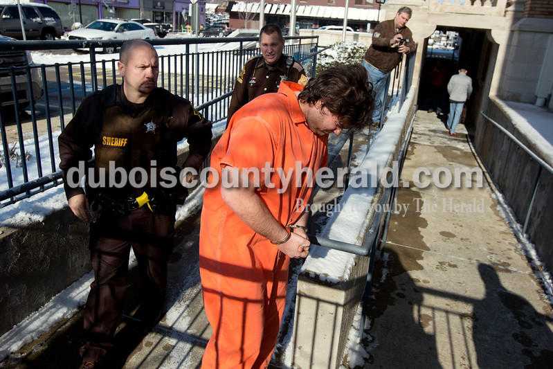 Ariana van den Akker/The Herald<br /> Kyle N. Popplewell of Ferdinand, suspect of Sunday's hostage and murder incident in St. Henry, was transported to the Dubois County Courthouse by Dubois County Sheriff's Department deputies on Monday.