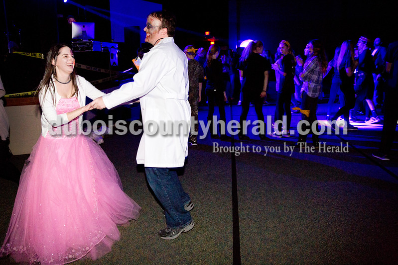 Heather Ferguson and Gregg Kieffner, both of Jasper, danced during Infected, a zombie-themed event hosted by The Well youth ministry at Christian Church of Jasper on Wednesday.