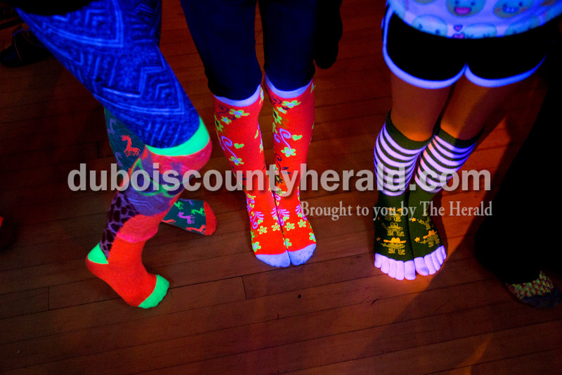 "Sarah Ann Jump/The Herald<br /> Penelope Roy of Holland, 9, left, Heather Schoenbachler of Huntingburg, 9, and Emily Ferguson of Huntingburg, 10, waited in line to go on stage for the crazy sock contest during a ""crazy sock"" themed party for third through fifth graders at Teen Outback in Huntingburg on Friday."