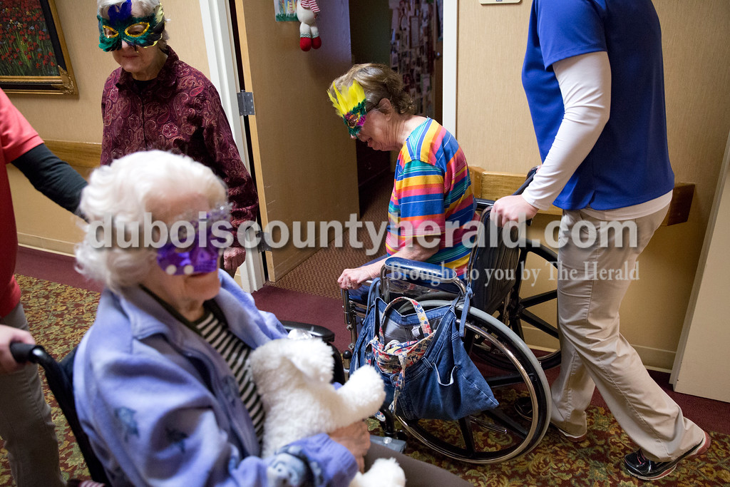 Sarah Ann Jump/The Herald<br /> Hilda Kuntz, bottom left, Roberta Harris and Mary Ella Ermert, all of Jasper, participated in a masquerade mask parade at St. Charles Health Center in Jasper on Friday.