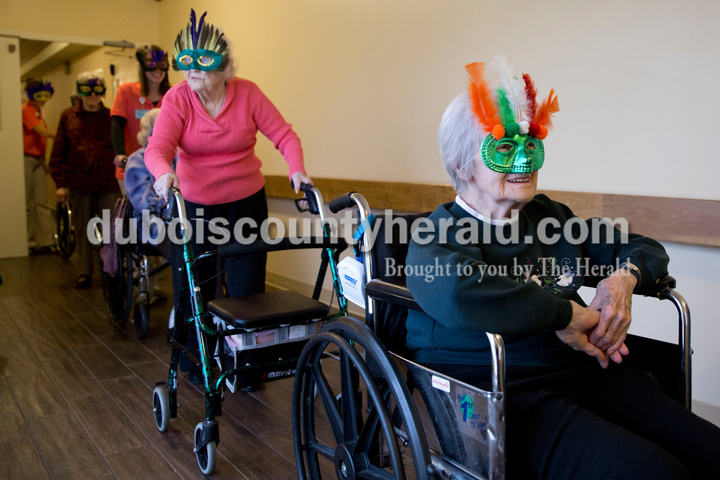 Sarah Ann Jump/The Herald<br /> Ruby Thimling of Jasper, right, smiled as she participated in a masquerade mask parade at St. Charles Health Center in Jasper on Friday.
