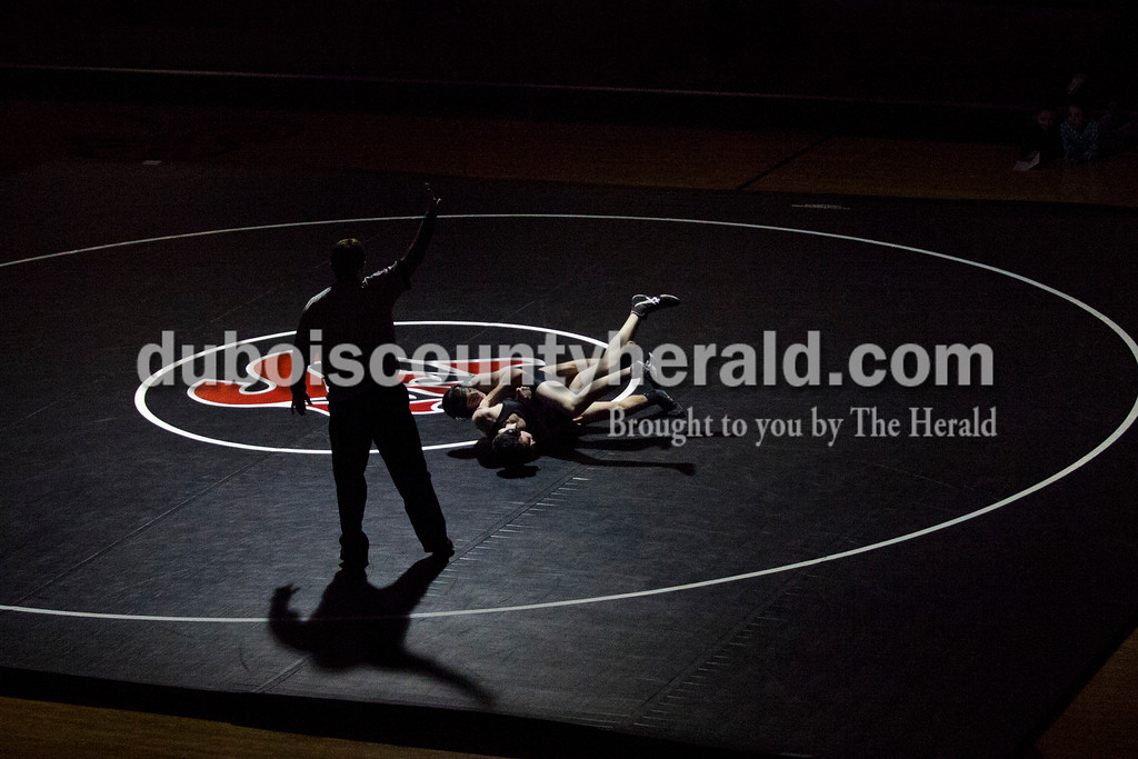 Southridge's Price Painter and Jasper's Landon Betz wrestled in the120-pound weight class during Tuesday's match at Memorial Gymnasium in Huntingburg. <br /> Alisha Jucevic/The Herald