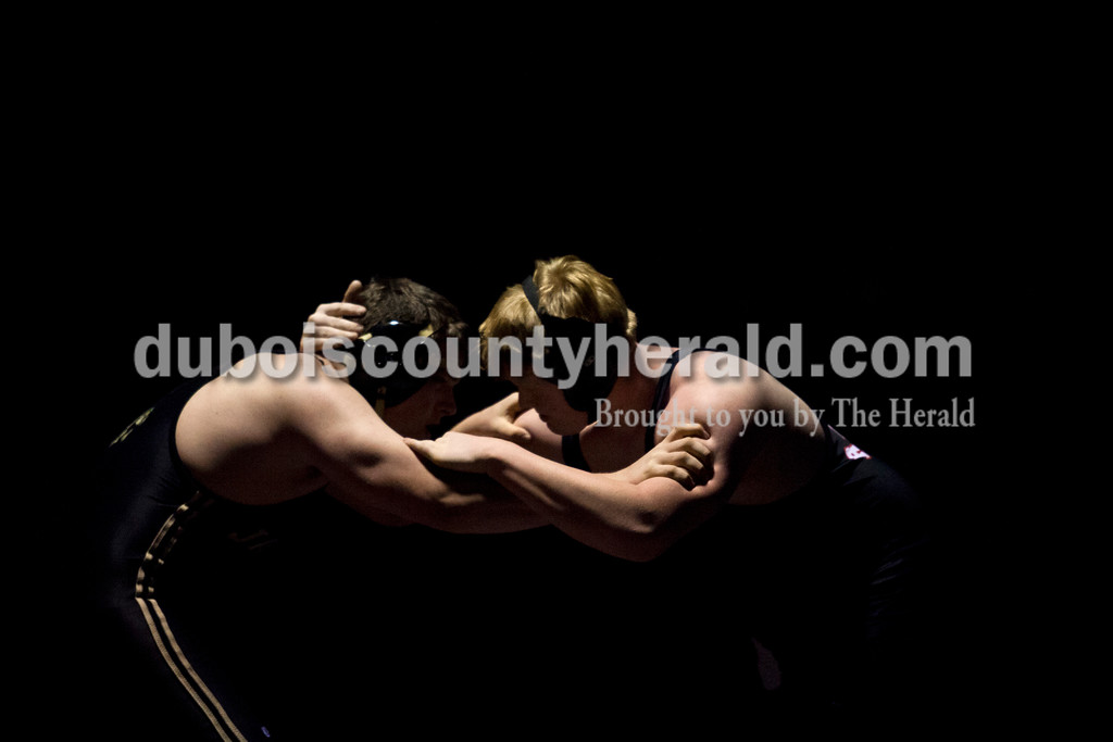 Jasper's Mason Thewes grappled with Southridge's Wyatt Kramer in the 220-pound weight class during Tuesday's match at Memorial Gymnasium in Huntingburg. <br /> Alisha Jucevic/The Herald