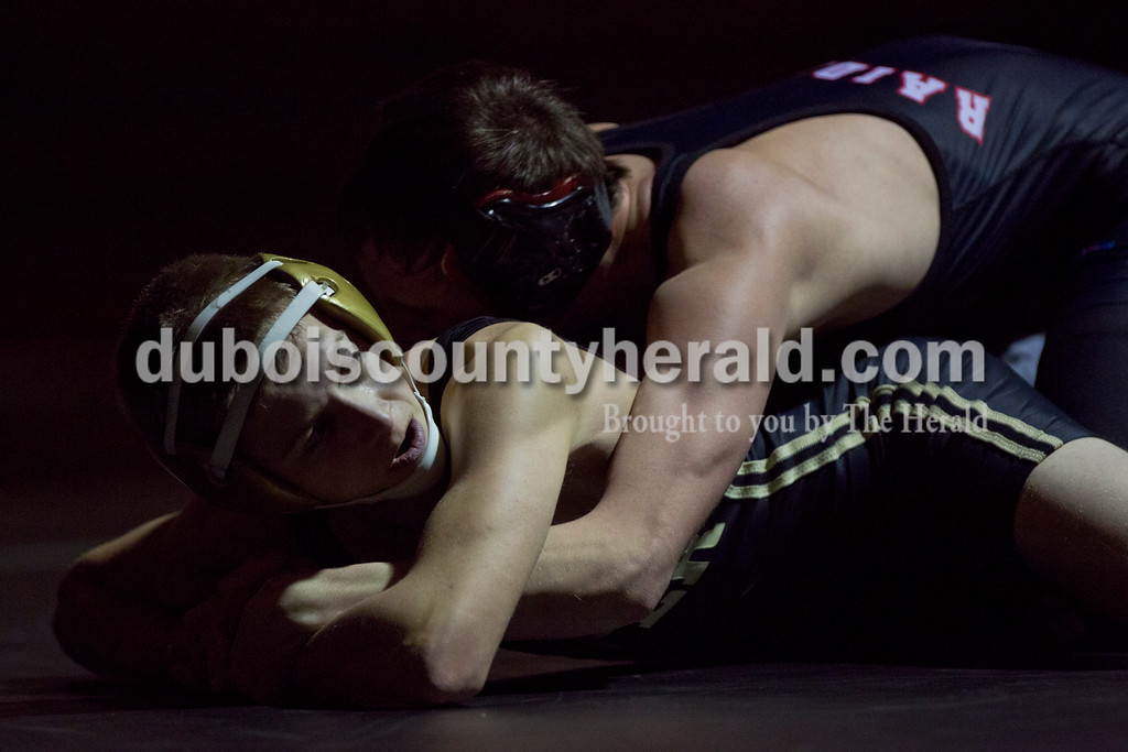 Jasper's Austin Hildenbrand wrestled Southridge's Hunter Meyerholtz in the 113-pound weight class during Tuesday's match at Memorial Gymnasium in Huntingburg. <br /> Alisha Jucevic/The Herald