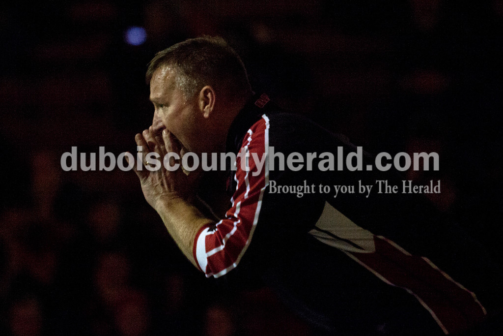 Southridge coach Dave Schank yelled to his wrestler, Wyatt Kramer, from the side of the mat during Tuesday's match against Jasper at Memorial Gymnasium in Huntingburg. <br /> Alisha Jucevic/The Herald