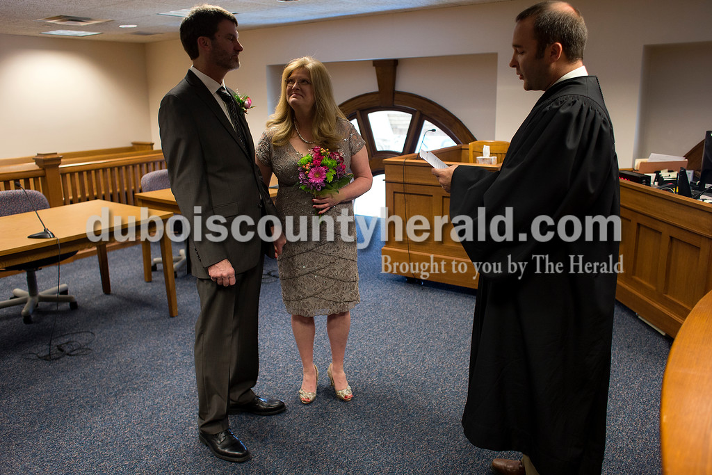 Dave Weatherwax/The Herald<br /> Judge Nathan Verkamp married Greg Ellis and Jeannie Hicks on Monday afternoon at the Dubois County Courthouse.