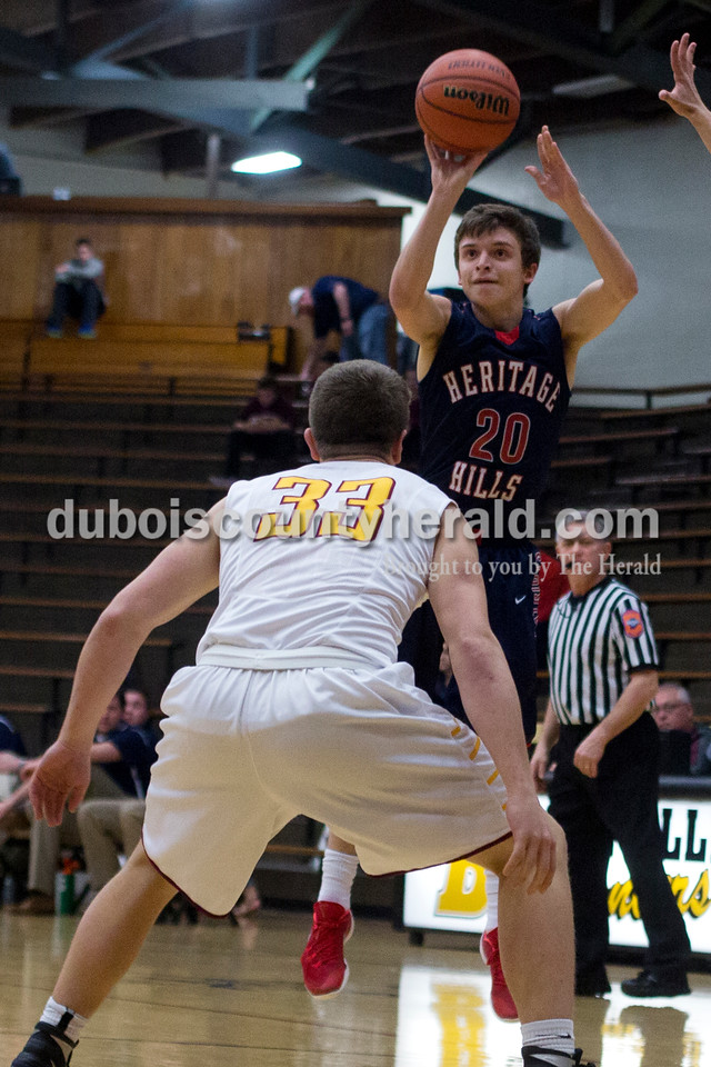 Heritage Hills' Dalton Selvidge shot the ball over Gibson Southern's Nicholas Sellers during the first round of the Class 3A sectional on Tuesday in Boonville. The Patriots won 55-52. Ariana van den Akker/The Herald