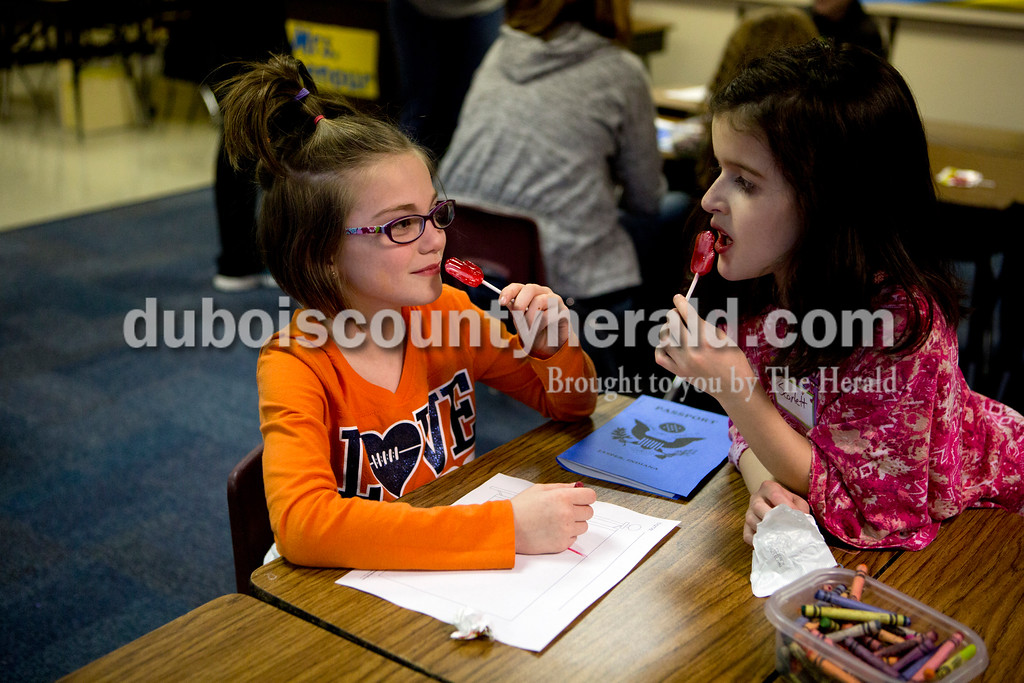 Ariana van den Akker/The Herald<br /> Fifth Street Elementary second-graders Taliyah Fleming, left, and Scarlett Rose Stofleth chatted during Multicultural Family Fun Night on Monday at the school in Jasper. The program, put on by Fifth Street Elementary and Tenth Street Elementary, featured crafts, activities and games to teach kids about different cultures. It was crazy hair day earlier at school.