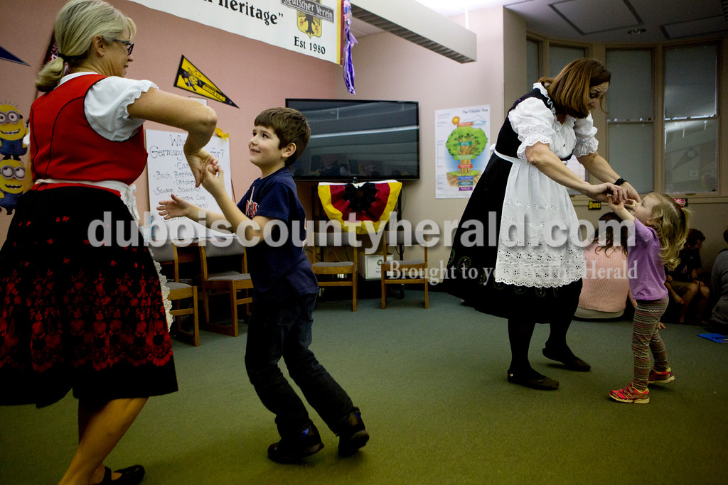 Ariana van den Akker/The Herald<br /> As polka music played, Yvonne Mullen, left, danced with Aiden Myers-Jackson, 7, both of Jasper, and Laura Grammer danced with Reese Schnaus, 3, both of Jasper during Multicultural Family Fun Night on Monday at Fifth Street Elementary in Jasper. The program, put on by Fifth Street Elementary and Tenth Street Elementary, featured crafts, activities and games to teach kids about different cultures.