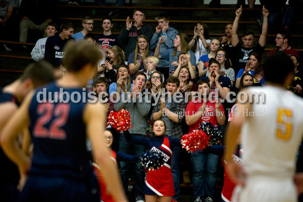 The Heritage Hills student section cheered after a successful free throw close to the end of first game of the Class 3A sectional against Gibson Southern on Tuesday in Boonville. The Patriots won 55-52. Ariana van den Akker/The Herald