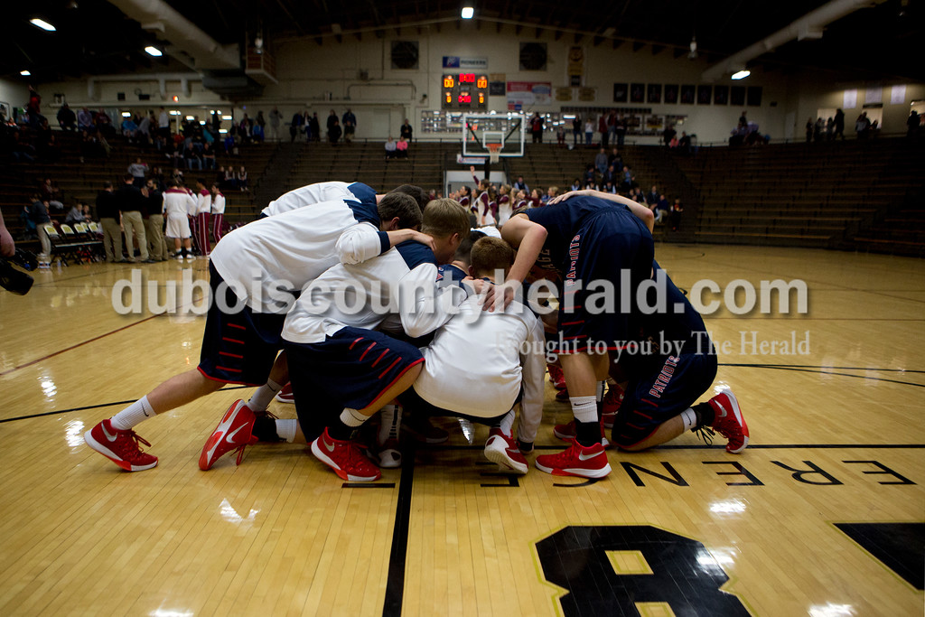 The Heritage Hills boys basketball team huddled on the court before the first round of the Class 3A sectional against Gibson Southern on Tuesday in Boonville. The Patriots won 55-52. Ariana van den Akker/The Herald