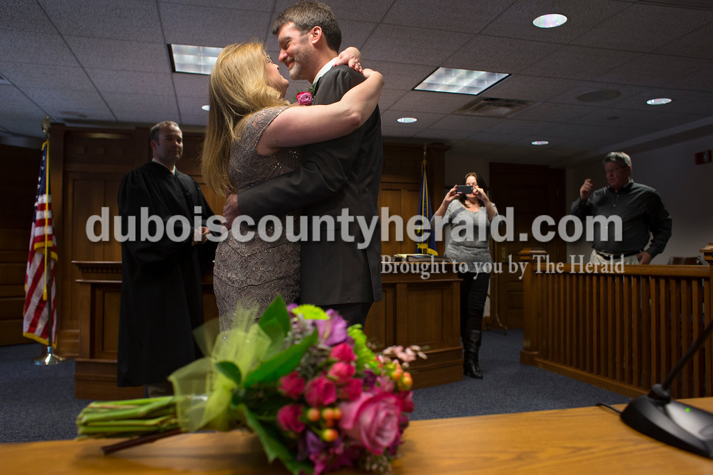 """Dave Weatherwax/The Herald<br /> Up until the moment that Jeannie Hicks and Greg Ellis, both of Jasper, were married on Monday, Feb. 29, at the Dubois County Courthouse in Jasper, the couple still hadn't decided how they will celebrate their future anniversaries of their Leap Day wedding. """"Gives me four years to remember,"""" Greg said."""
