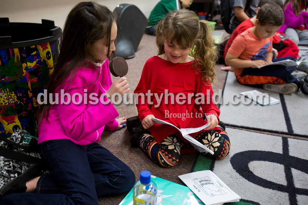 Huntingburg Elementary School fourth-grader Joselyn Hernandez, left, read with kindergartener Abigail Flamion during ReadQuest on Friday afternoon at Huntingburg Elementary School. ReadQuest was a one-day national event bringing students together to celebrate the power of reading.