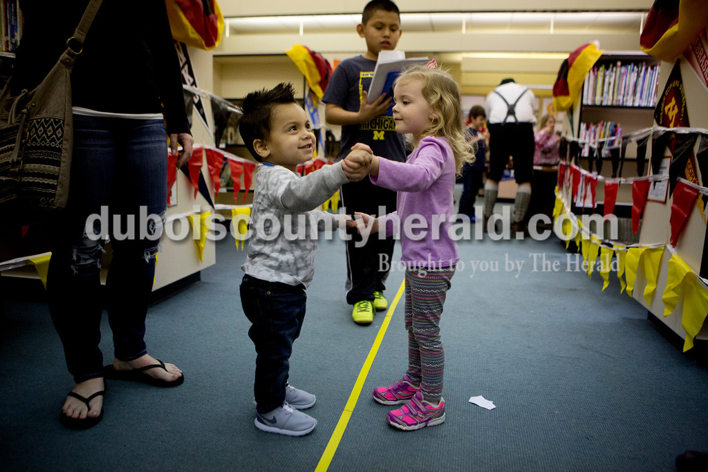 Ariana van den Akker/The Herald<br /> Brady Martinez, 1, left, danced with Reese Schnaus, 3, both of Jasper during Multicultural Family Fun Night on Monday at Fifth Street Elementary in Jasper. The program, put on by Fifth Street Elementary and Tenth Street Elementary, featured crafts, activities and games to teach kids about different cultures.