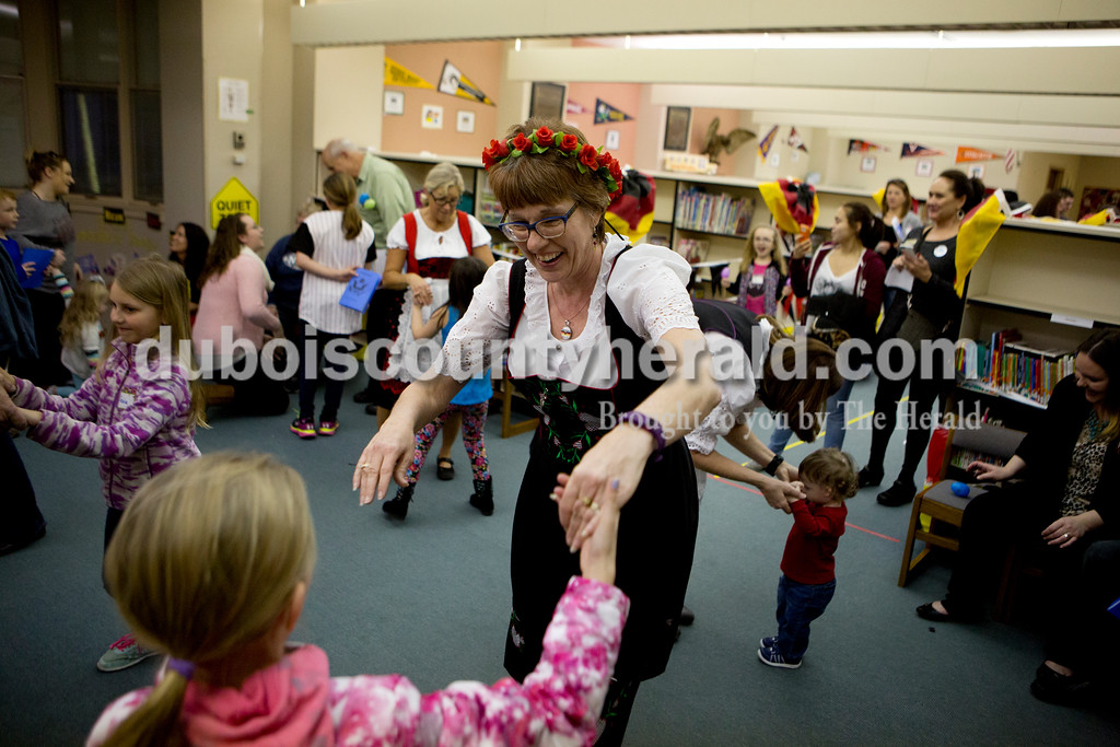 Ariana van den Akker/The Herald<br /> Ann Ackerman, center, taught Josie Rees, both of Jasper, how to dance a polka during Multicultural Family Fun Night on Monday at Fifth Street Elementary in Jasper. The program, put on by Fifth Street Elementary and Tenth Street Elementary, featured crafts, activities and games to teach kids about different cultures.