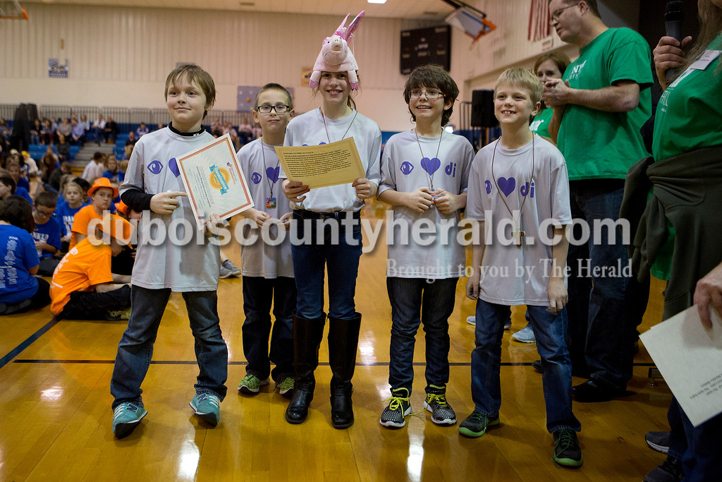"""Ariana van den Akker/The Herald<br /> The """"Unsinkables"""" made up of Holy Trinity Catholic third-graders Xavier Rasche, left, Landon Fuhs, Monica Lorey, Sam Osterman and Levi Welp, received first place in the elementary division of the fine arts challenge at the Destination Imagination Regional Tournament in Sellersburg on Saturday. The team also took home two special awards, a """"Renaissance Award"""" and the """"Spirit of DI"""" award."""