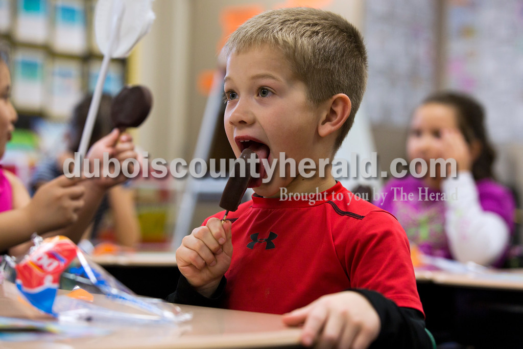 Huntingburg Elementary School first-grader Clint Wirthwein enjoyed a Dairy Queen Dilly Bar during ReadQuest on Friday afternoon at Huntingburg Elementary School. In celebration of finishing their reading projects, all of the classes got to enjoy Dilly Bars at the end of the day.