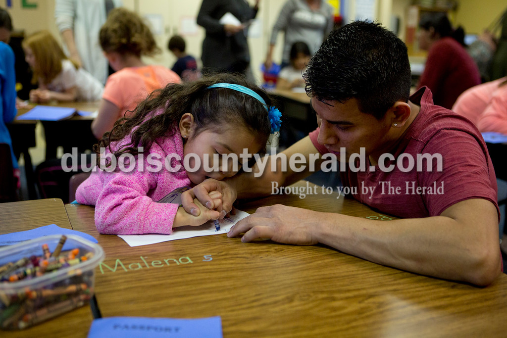 Ariana van den Akker/The Herald<br /> Elder Martinez of Jasper helped his daughter Lezly, 3, create a Guatemalan flag during Multicultural Family Fun Night on Monday at Fifth Street Elementary in Jasper. The program, put on by Fifth Street Elementary and Tenth Street Elementary, featured crafts, activities and games to teach kids about different cultures. Elder was born in Guatemala.