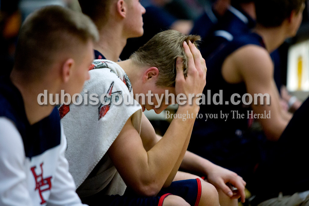 Heritage Hills' Carter Meunier was nervous in the last minutes of the game during the first round of the Class 3A sectional against Gibson Southern on Tuesday in Boonville. The Patriots won 55-52. Ariana van den Akker/The Herald