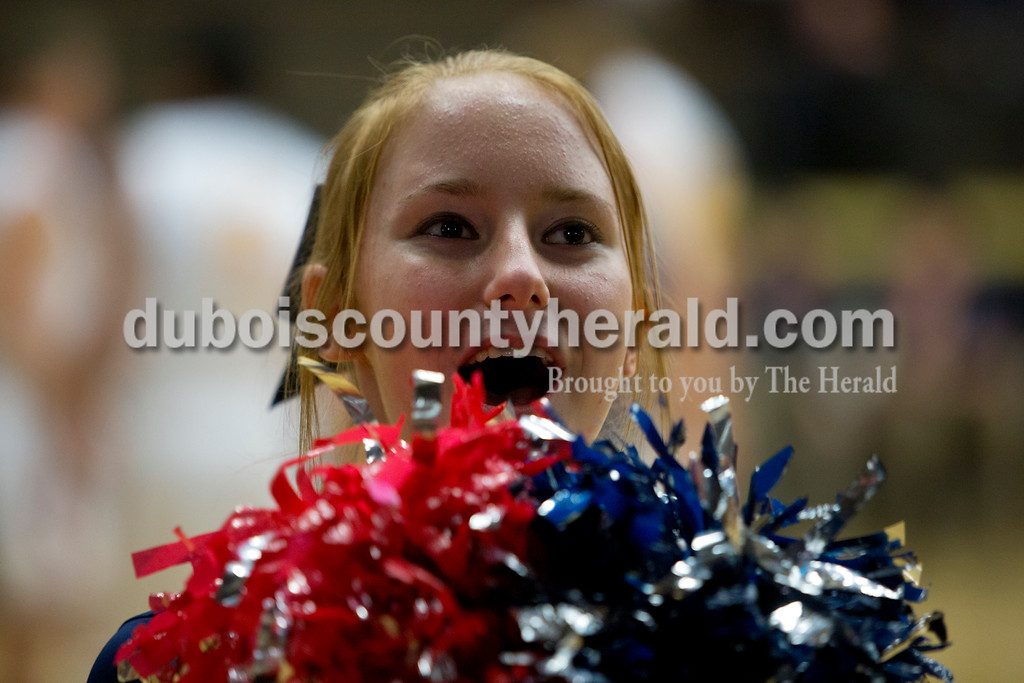 Heritage Hills freshman Emily Frakes cheered during the first round of the Class 3A boys basketball sectional against Gibson Southern on Tuesday in Boonville. The Patriots won 55-52. Ariana van den Akker/The Herald