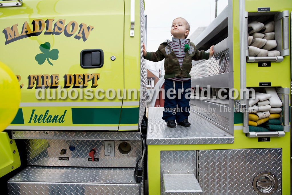 Sarah Ann Jump/The Herald<br /> Owen Vogler of Ireland, 2, took in the view from a firetruck at the Ireland Fire Station during the St. Patrick's Celebration on Saturday.