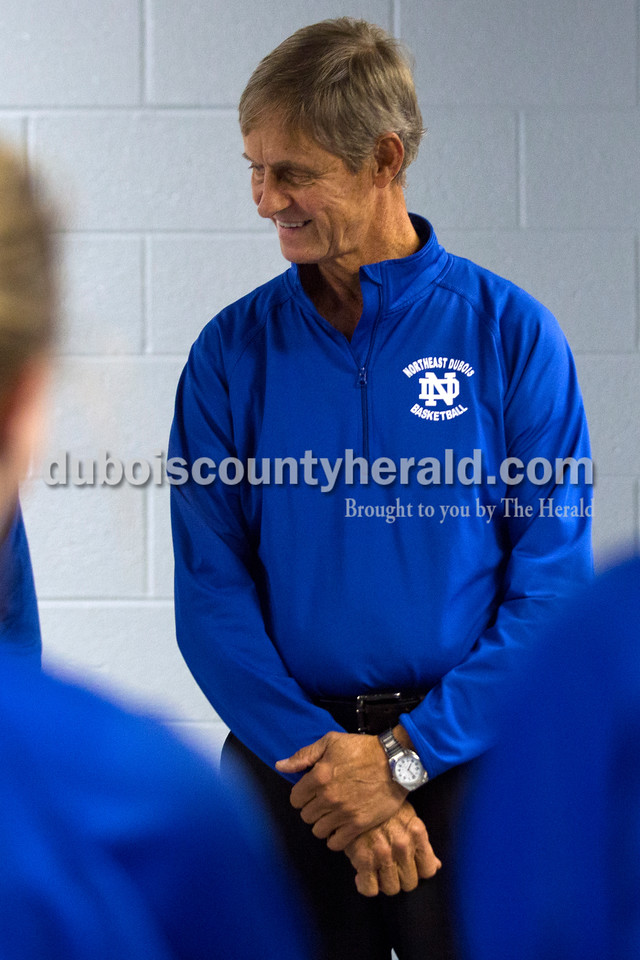 """Northeast Dubois' head coach Alan Matheis, a.k.a. """"Spider"""", prayed with his team before the game against Heritage Hills on Thursday, Nov. 12, in Lincoln City. The Jeeps won 37-30. <br /> Alisha Jucevic/The Herald"""
