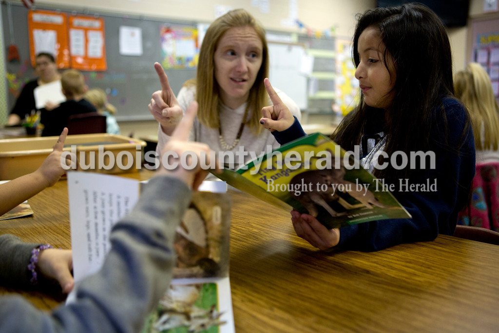 """Ariana van den Akker/The Herald<br /> While reading about baby Kangaroos on Tuesday morning, Fifth Street Elementary English Language Learner teacher Lindsey Healy and first-grader Emily Pineda visualized how big a baby kangaroo or """"joey"""" would be at birth."""