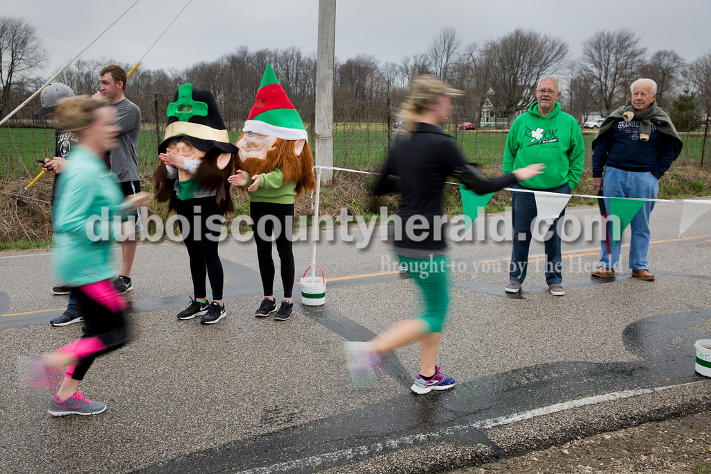 Sarah Ann Jump/The Herald<br /> Dressed as leprechauns, Mariah Seifert and Anna Moeller, both 16 and of Ireland, greeted runners at the finish line of Saturday's Irish Trot 5K at Ireland Elementary School.