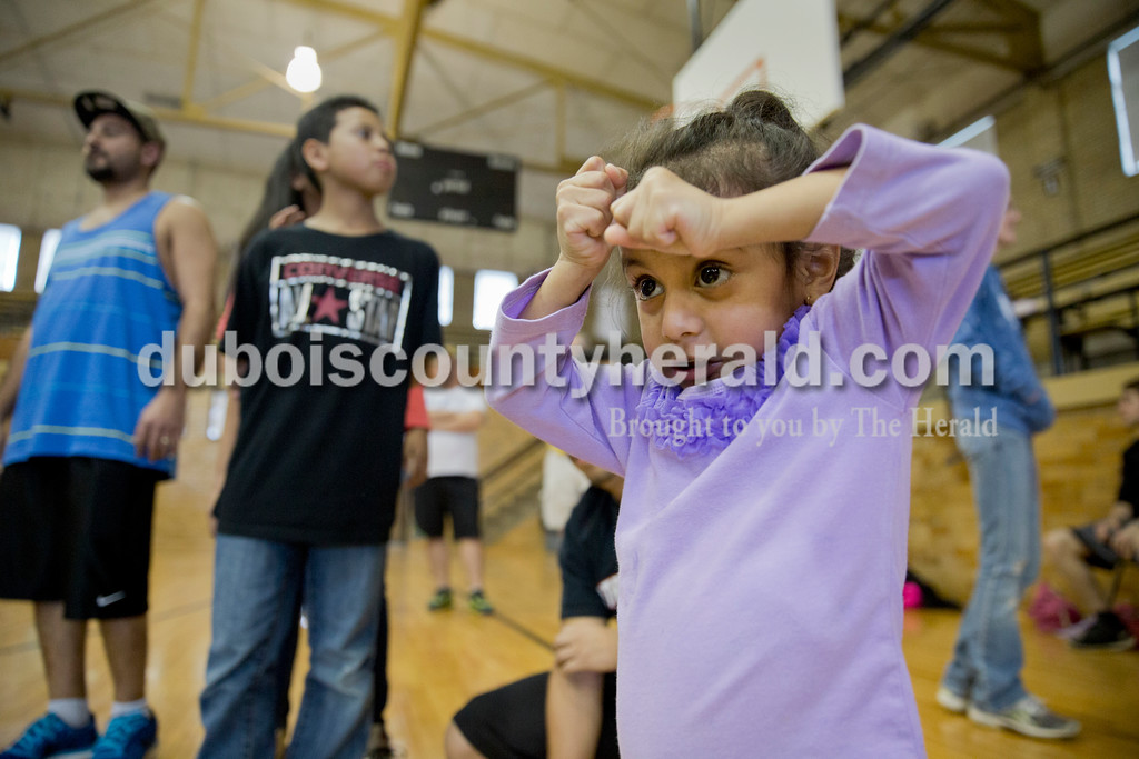 Sarah Ann Jump/The Herald<br /> Sophia Figueroa of Jasper, 2, braced as she watched her brother Marvin, 6, wrestle during Wednesday's Jasper Youth Wrestling meet at Cabby O'Neill Gymnasium in Jasper.