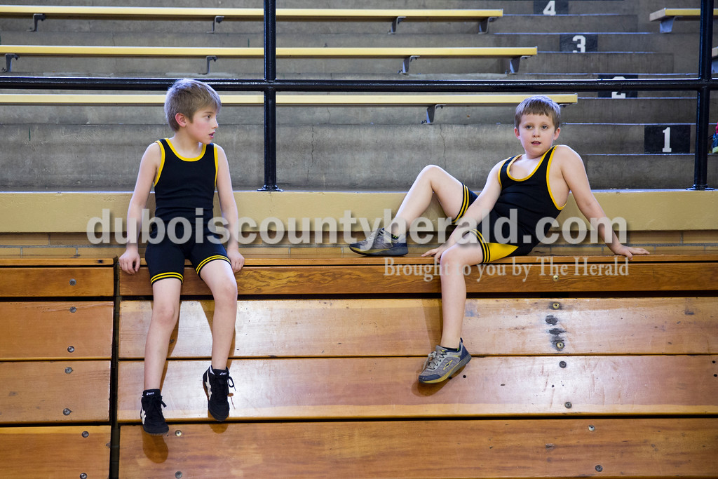 Sarah Ann Jump/The Herald<br /> Ervin Williams, 7, left, and Jace Land, 8, both of Jasper, relaxed on the bleachers between matches during Wednesday's Jasper Youth Wrestling meet at Cabby O'Neill Gymnasium in Jasper.
