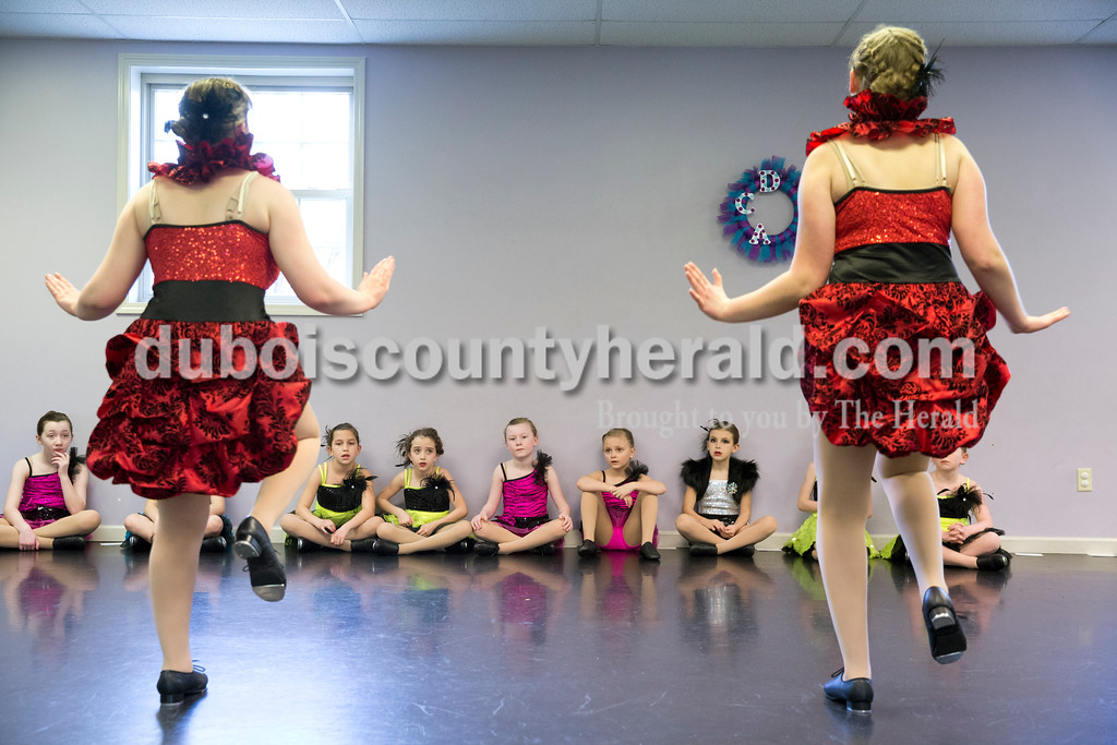 Sarah Ann Jump/The Herald<br /> Young dancers watched as Olivia Hedinger, 14, left, and Anna Wagner, 16, both of Jasper, performed during Sunday's practice at Dance Central Academy of Performing Arts in Jasper. 48 dancers from the academy are traveling to Walt Disney World in Florida over spring break to perform at Disney Springs on Sunday, March 20 and participate in dance workshops on Tuesday, March 22.