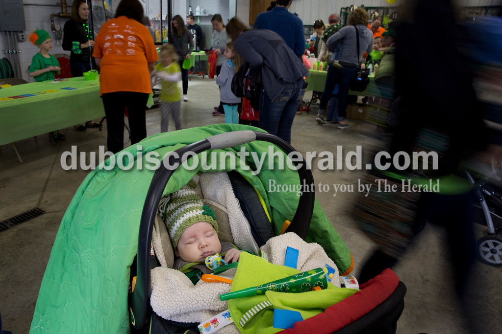"""Sarah Ann Jump/The Herald<br /> Maddox Miller of Ireland, 2 months, slept at the Ireland Fire Station during the St. Patrick's Celebration on Saturday. """"He'll sleep through about anything,"""" said his mother Jessica Miller."""