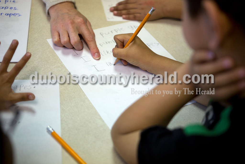 Ariana van den Akker/The Herald<br /> Fifth Street Elementary English Language Learner teacher Lindsey Healy encouraged kindergartener Alexander Padilla to finish writing his sentences during a session at the school in Jasper on Tuesday morning.