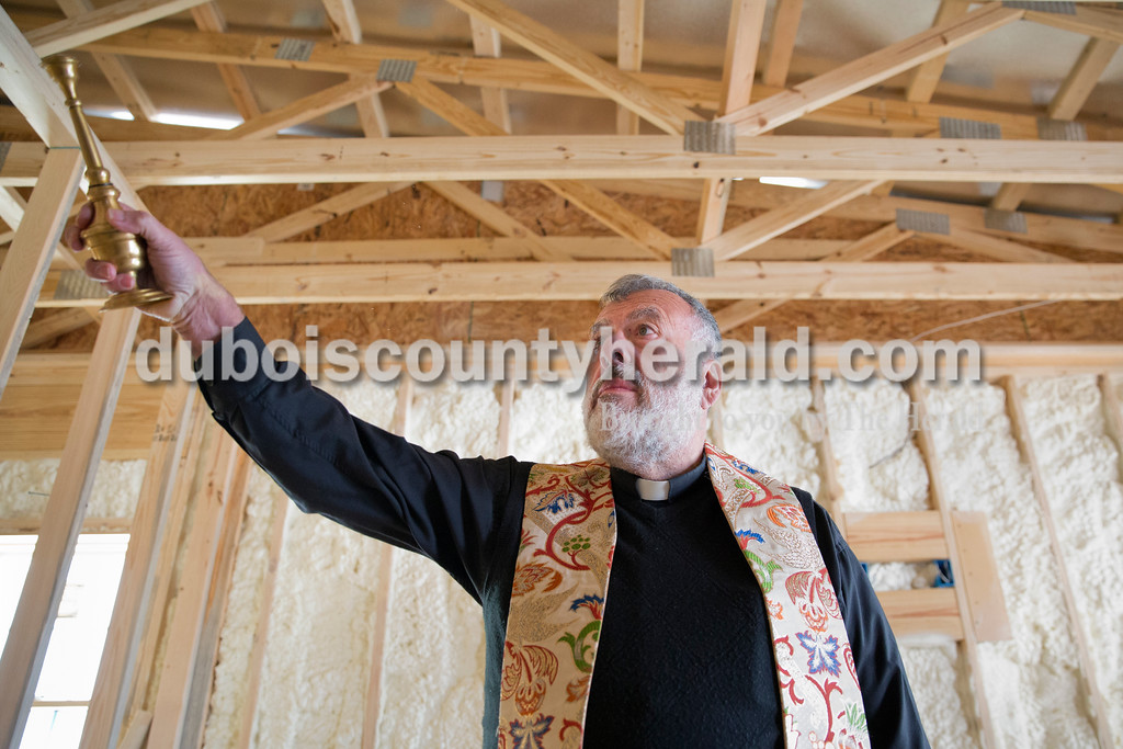 Father John Boeglin of Jasper blessed Patoka Lake Winery in Birdseye, which was under construction, on Tuesday, Jan. 12, 2016.