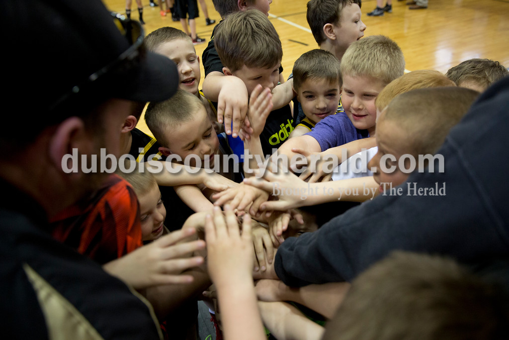 Sarah Ann Jump/The Herald<br /> A team gathered together before Wednesday's Jasper Youth Wrestling meet at Cabby O'Neill Gymnasium in Jasper.