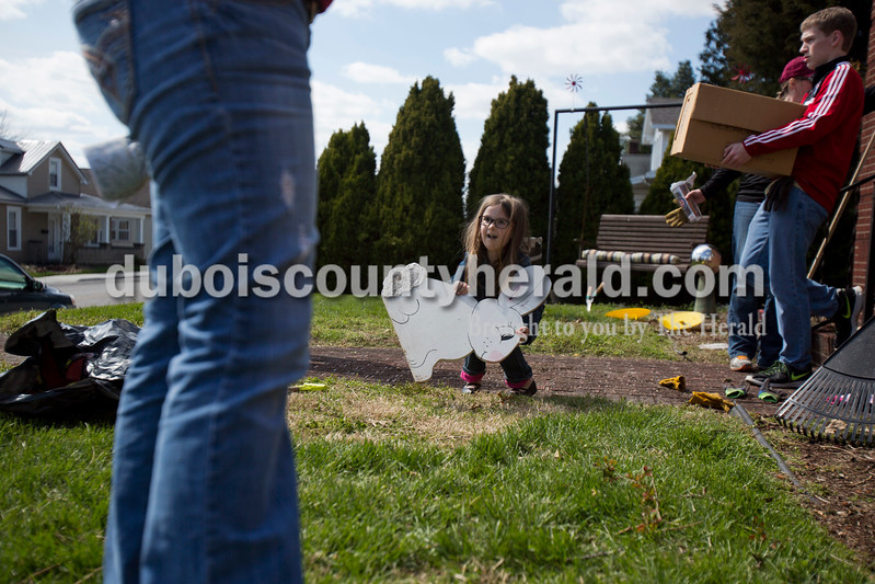 Alisha Jucevic/The Herald <br /> <br /> Jordan Wuchner of Jasper, 5, carried the family Easter bunny out to her grandmother's front yard on Monday afternoon in Jasper. Arlene Wuchner said she bought a wooden bunny 16 years ago when her first grandchild was born and for each new grandchild, she paints a new egg to put out with the bunny for Easter. Jordan is the youngest of Arlene's 12 grandchildren.