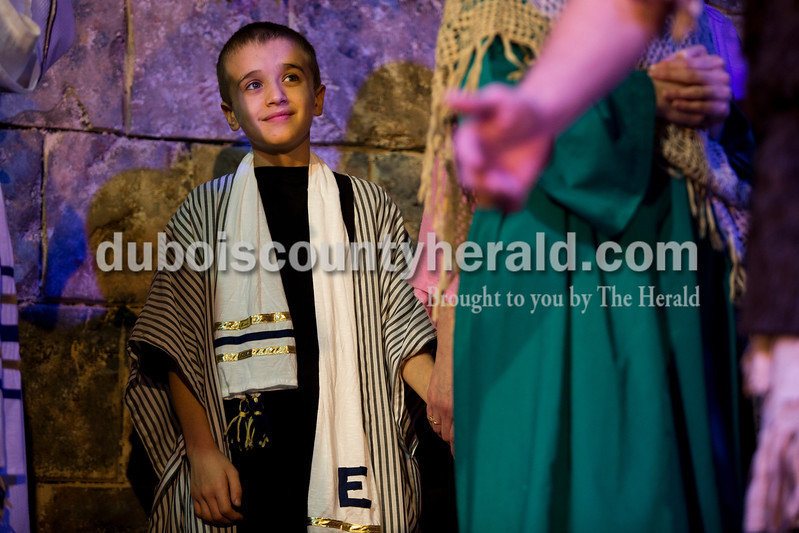 "Alisha Jucevic/The Herald <br /> <br /> Eli Zook of Ireland, 11, listened to John the Baptist, played by Dave Drew of Jasper, during Wednesday night's dress rehearsal of ""One Voice,"" a dramatic Easter musical, at Victory Temple Assembly of God in Jasper."