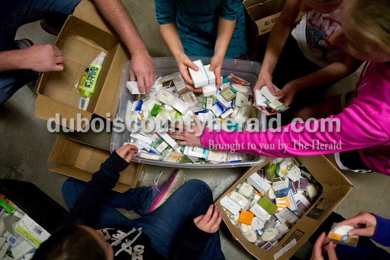 Sarah Ann Jump/The Herald<br /> Members of youth groups from Shiloh United Methodist Church and Otwell United Methodist Church sorted toiletries at Helping His Hands Disaster Response warehouse in Vincennes on Tuesday. The donated toiletries will be used to make health kits for distribution to disaster victims.