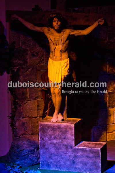 """Alisha Jucevic/The Herald <br /> <br /> Playing the role of Jesus Christ, Phil Michel of Huntingburg, was crucified on the cross during Wednesday night's dress rehearsal of """"One Voice,"""" a dramatic Easter musical, at Victory Temple Assembly of God in Jasper."""