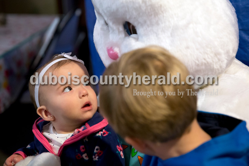 Sarah Ann Jump/The Herald<br /> Sadie Hall of Dubois, 11 months, looked at the Easter Bunny as she sat on his lap with her brother Chance, 3, during Breakfast with the Easter Bunny sponsored by the Dubois Ruritan Club at Dubois Community Park on Saturday.