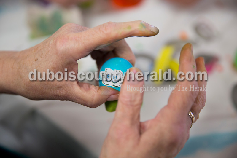 Sarah Ann Jump/The Herald<br /> Bernice Brosmer of Jasper added a sticker to a dyed easter egg at Northwood Retirement Community in Jasper on Wednesday.